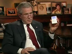 George W. Bush shows off his Apple iPod