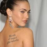 Megan Fox wearing Elegant Earrings showing Back Tatoo
