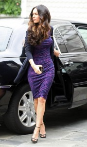 Megan Fox with her iPhone getting out of limo