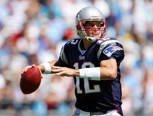 tom brady throwing a football