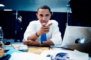 Barack Obama and his Mac with Pac-man sticker