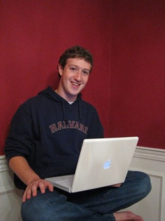 Mark Zuckerberg, Facebook CEO, Entrepreneur, with his Apple Mac laptop and Harvard shirt