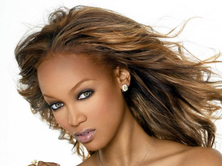 Tyra Banks supermodel wearing diamond earrings