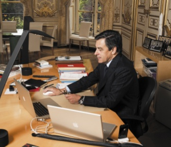 François Fillon with two Apple MacBook Pro laptops and black iPhone