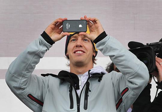 Sebastian Vettel F1 Racing Champion, uses iPhone 4, Heppenheim