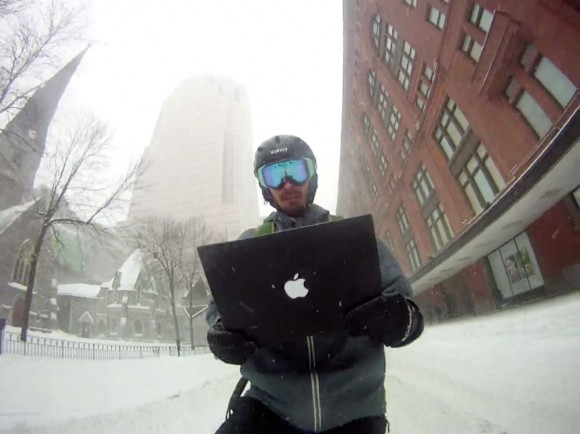 Montreal bicycle man uses Mac in snow